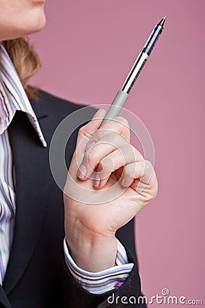 Businesswoman gesturing with pen