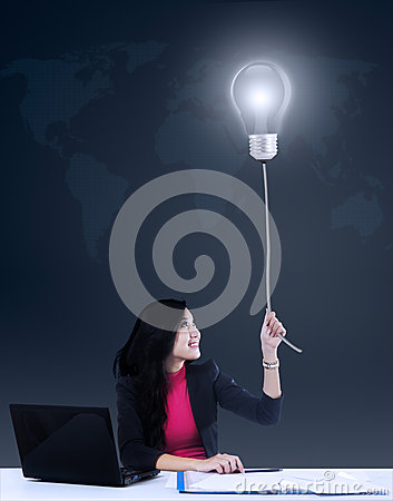 Businesswoman getting a bright idea