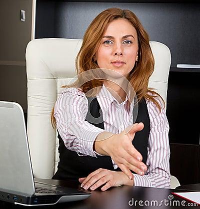 Businesswoman giving handshake