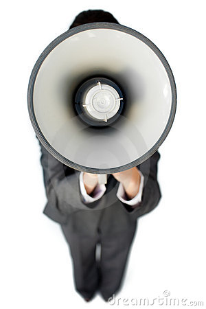 Businesswoman giving instructions with a megaphone