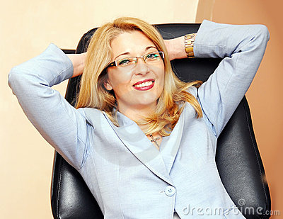 Businesswoman in glasses gesture