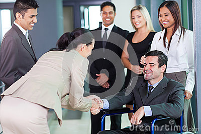 Businesswoman greeting partner