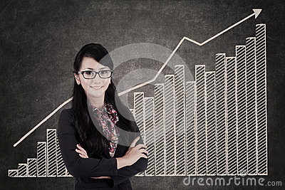 Businesswoman and growing bar chart