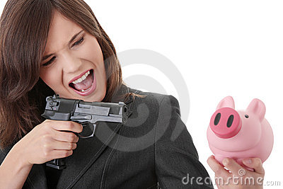 Businesswoman with gun pointing at piggy bank
