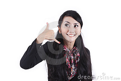 Businesswoman with hand gesture to call her