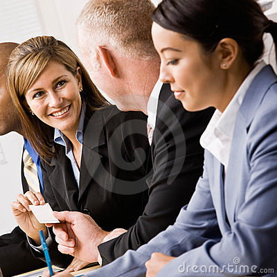 Free Businesswoman Handing Co-worker Business Card Stock Images - 6603224