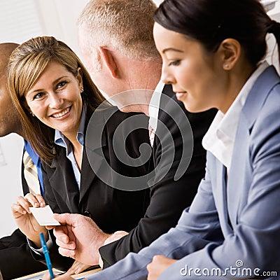 Businesswoman handing co-worker business card
