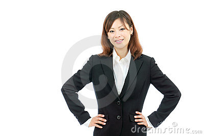 Businesswoman with hands on hips