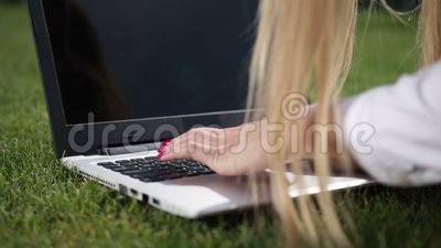 Businesswoman hands typing on a laptop outdoor stock video
