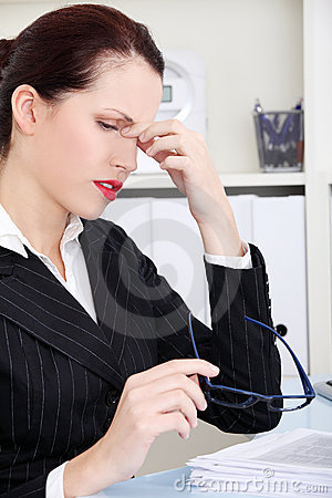 Businesswoman having headache.
