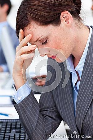 Businesswoman having a migraine at work
