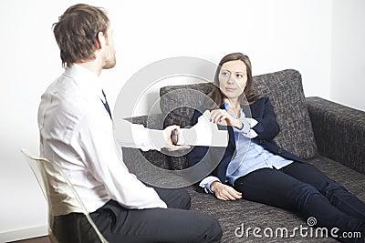 Businesswoman having psychoanalysis