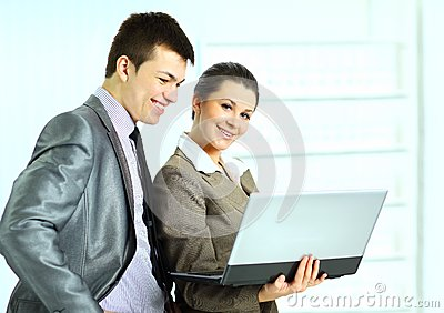 Businesswoman with her colleagues using laptop