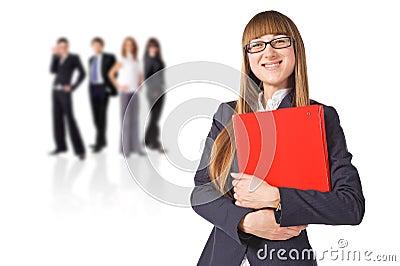 Businesswoman  with her teamwork behind