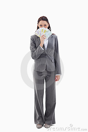 Businesswoman hiding with bank notes in her hand