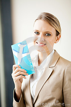 Businesswoman holding air ticket