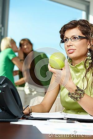 Businesswoman holding apple