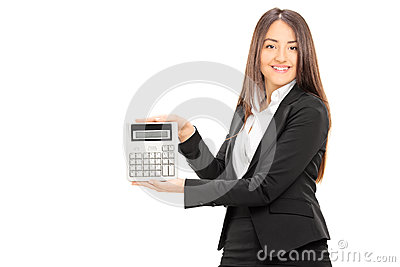 Businesswoman holding a calculator