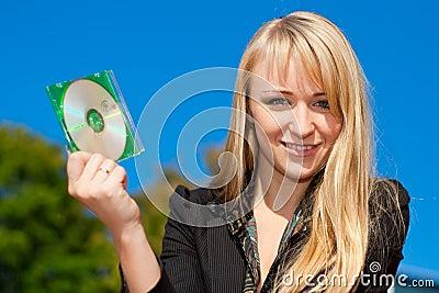 Businesswoman holding CD