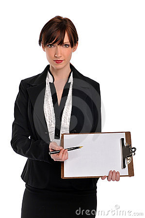 Businesswoman holding clipboard and pen