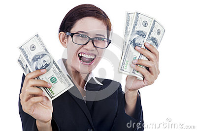 Businesswoman holding dollar bills