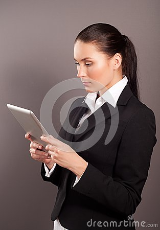 Businesswoman holding her digital tablet pc