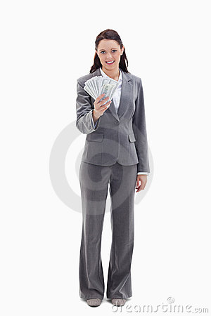 Businesswoman holding a lot of dollar bank notes