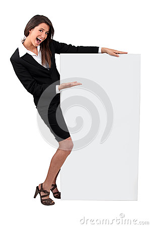 Businesswoman holding message board