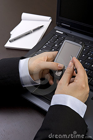 Businesswoman holding modern mobile pda phone