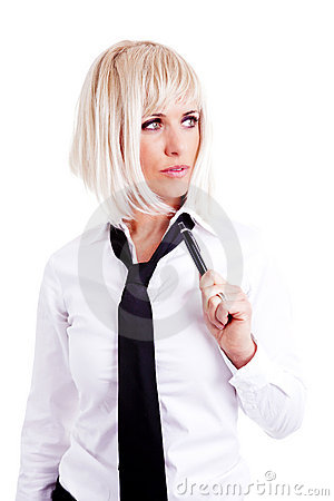 Businesswoman holding pen over white