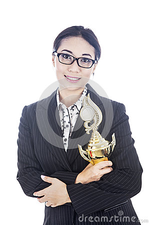 Businesswoman holding trophy in her hands