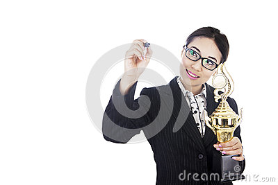 Businesswoman holding trophy writing on copyspace