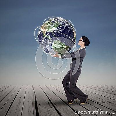 Businesswoman holding the world