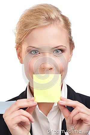 Businesswoman holding a yellow sticker