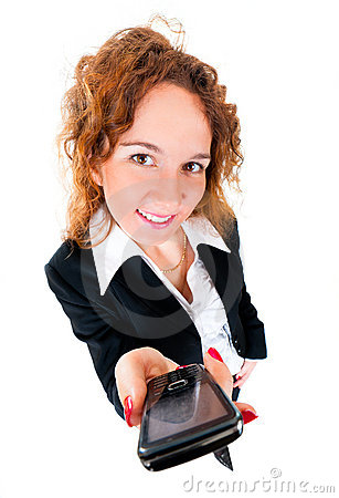 Businesswoman holds out a mobile phone.