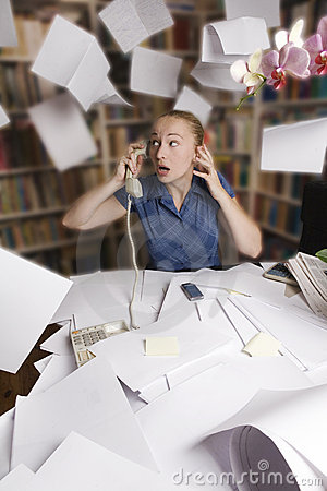 Free Businesswoman In Her Office And Flying Paper Sheet Royalty Free Stock Photo - 9780625