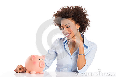 Businesswoman Looking At Piggybank