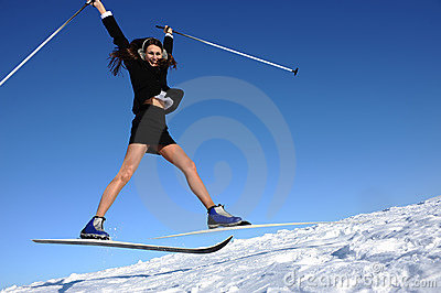 Businesswoman jumping on ski