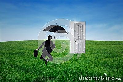 Businesswoman jumps in front of opportunity door