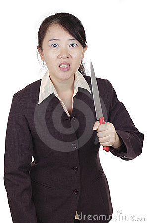Businesswoman with knife
