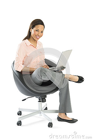 Businesswoman With Laptop Sitting On Office Chair