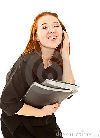 Businesswoman laughing and calling to  telephone