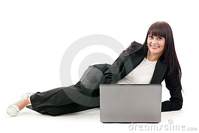 Businesswoman lay with laptop