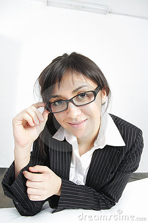 Businesswoman leaning on sofa