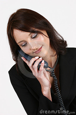 Businesswoman listening to caller on the phone