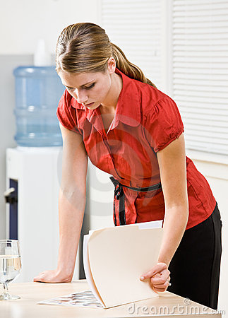 Businesswoman looking at file folder