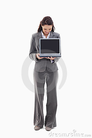 Businesswoman looking and showing a laptop screen