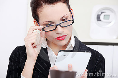 Businesswoman looking at tablet.