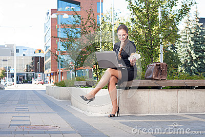 Businesswoman making lunch outdoor