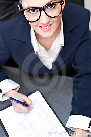 Businesswoman making note business
